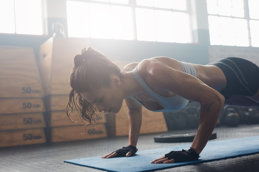 Woman working out with self discipline